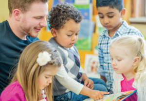 Early learning educators reads to children